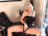 Busty blond pleasures herself with vibrator before giving handjob and taking cum to the eye