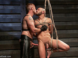 Bald hunk gets tied up, waxed and fucked so hard
