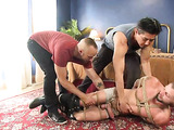 Horny bear dudes having a nasty fun with a tied up man
