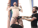 Bearded gay hunk in bondage gets his dick stimulated