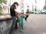 Brunette teen whore in a green dress gets nailed in public
