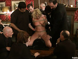 Tied up blonde pornstar sucks many dicks in this freaky session