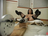 Brunette lady in black stockings gets nailed by fucking machines