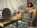 Busty black girl rides her favorite fucking machines