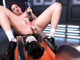 Redhead teases her cunt and gets rammed by a fucking machine