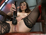 Long haired woman in black stockings gets her twat drilled hard