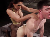Brown haired tranny in fishnets fucks a young stud