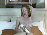 Slim blonde babe with golden hair plays her pussy with magic wand till she pulsates in orgasm