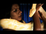Absolutely stunning Bollywood darling posing with her white snake