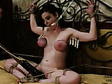 Girl in black lingerie and fishnets gets tities bondaged until it's red.