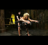 Blonde lady gets flogged while bound and with nipple clips.