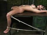 Blondie gets her legs over head while ass-bondaged by masked man.
