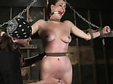 Brunette bound on floor with clothespins all over body gets flogged!