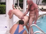 Gorgeous looking bald guy rims and licks up another man's intimate before pounding his asshole by the pool