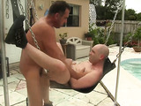 Matured top with horny cock ass fucking a dick hungry bottom on a sling by the pool