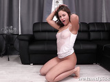 Perky chick masturbates and squirts on the living room sofa.