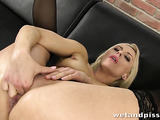 Hot blonde in sip-up panties shows her pussy and uses a big dildo.