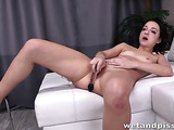 Horny chick licks her piss off the living room chair.
