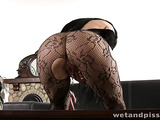 Black-haired beauty in heels squirts and masturbates on the coffee table.