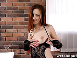 Redhead goes into the dining room to play with her wet cunt.