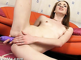 Hot chick fingers and toys with her holes on the sofa.