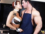 Redhead maid with big boobs  wearing black and white uniform with black stockings and high heels tells the hunk cook about how sick she is serving their master then seduces him by going down on the floor and suck his huge cock in the kitchen.