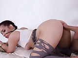 Cute braids and torn tights handle a huge cock on a pile of cash