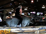 Gorgeus blonde shows her hot tits and sex skills while riding a mechanic bull