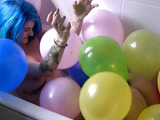 Punk rock girl pops balloons in tub to reveal her big tits