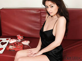 Long dark-haired beauty loves red, chocolates and black and she'll willing to seduce you with her daydreams