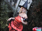 Blonde poses in witch costume and shows massive tits under bra