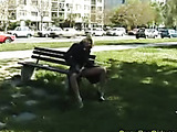 Nasty blonde slut poses in a park and takes a pee