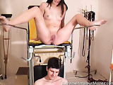 Girl lying down on a nurse bed will piss over her partner's head and then receive a facial comshot
