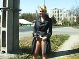 Super hot blonde slut takes a pee near a busy road
