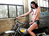Hot engines really turn her on and she loves to ride motorcycles bare naked and horny