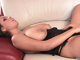 chick in black lace undies plays with her pussy on the couch