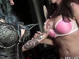 Big breasted babe sucks on a slut's huge strap on.