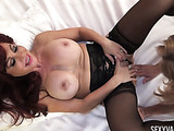 Sexy redheaded milf with pouty lips in black stockings has her friend rub her pussy till it's wet