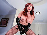 Busty redhead MILF wearing black leather outfit and fishnet stockings loves long poles in her pussy