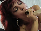 Busty redhead in black stockings fucked by sex machine from behind and loves it