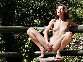 skinny brunette exhibitionist sits