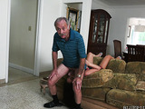 Busty dark haired lass in short dress licking balls of an old man and then blowing and deepthroating his cock on her knees