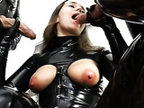 Brunette babe sucks two cocks at once belonging to two leather guys