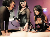 Three misstresses in leather play with a dick, tie it and pricke it with toys