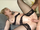 Horny blonde milf in black lingerie gets her pussy fucked by a huge cock