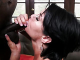 Horny milf deep throats a giant cock in the living room.