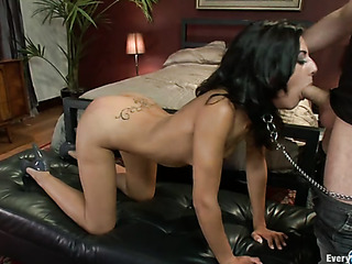 chained brunette with small