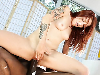 inked redhead uses two